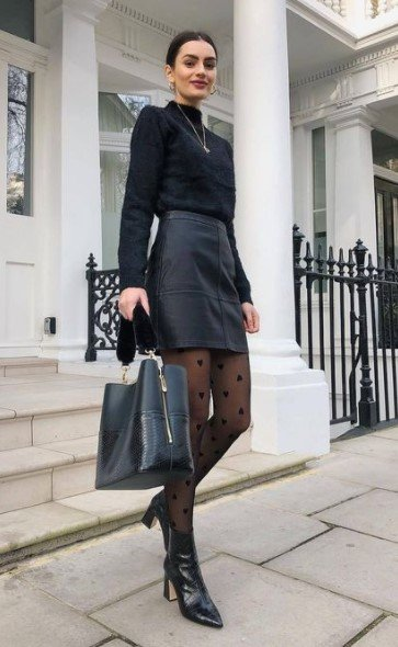 falda de cuero negro suéter negro oculta la grasa lateral