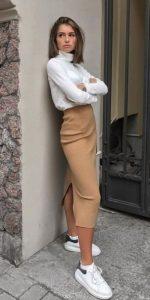 traje de invierno con falda midi