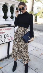 falda de leopardo crucero blusa negra