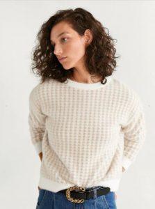 suéter de punto blanco