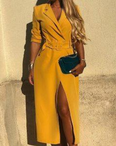 vestido midi amarillo con cinturón y lágrima