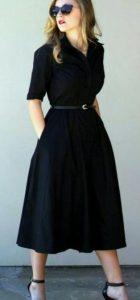 vestido negro de mujer con manga larga y cinturón en la cintura